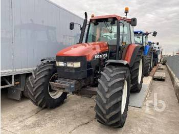 NEW HOLLAND M135 - جرار بعجل