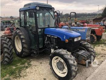 NEW HOLLAND TN90F - جرار بعجل