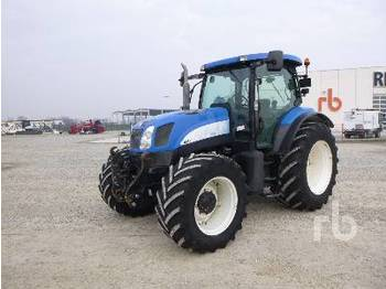 NEW HOLLAND TS135A - جرار بعجل